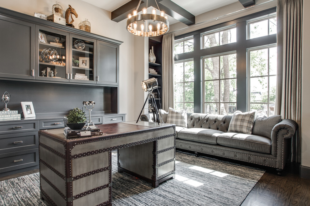 Study room - transitional freestanding desk dark wood floor study room idea in Dallas with gray walls and no fireplace