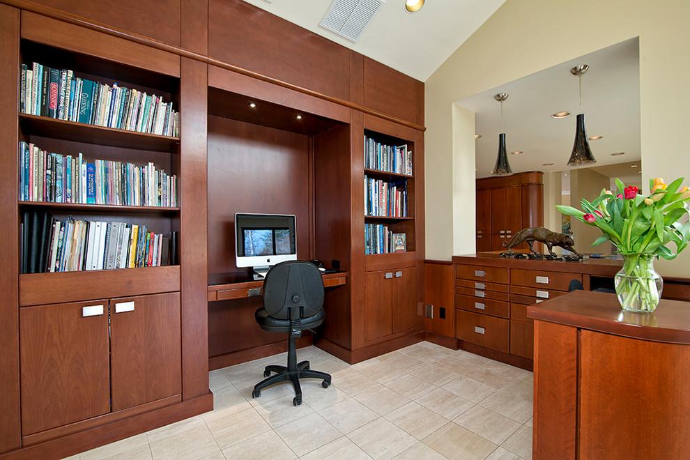 Example of a trendy built-in desk beige floor home office design in DC Metro