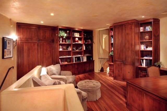 Mid-sized elegant freestanding desk dark wood floor and brown floor study room photo in Denver with beige walls and no fireplace