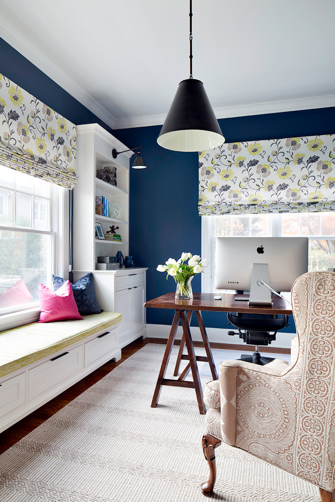 Example of a transitional freestanding desk dark wood floor home office design in New York with blue walls