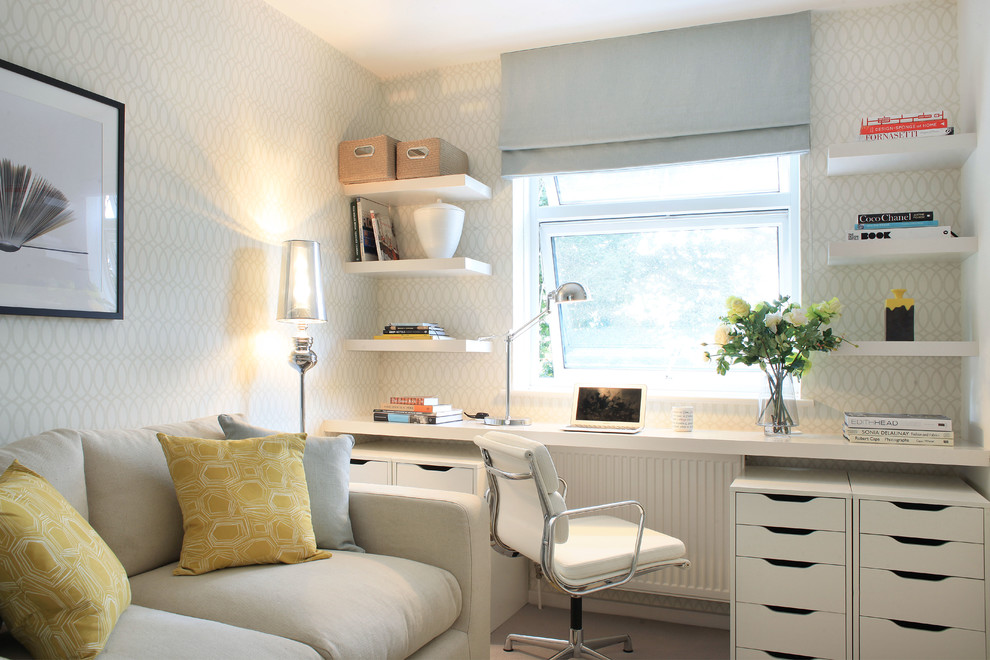 Study room - mid-sized transitional built-in desk study room idea in London with multicolored walls