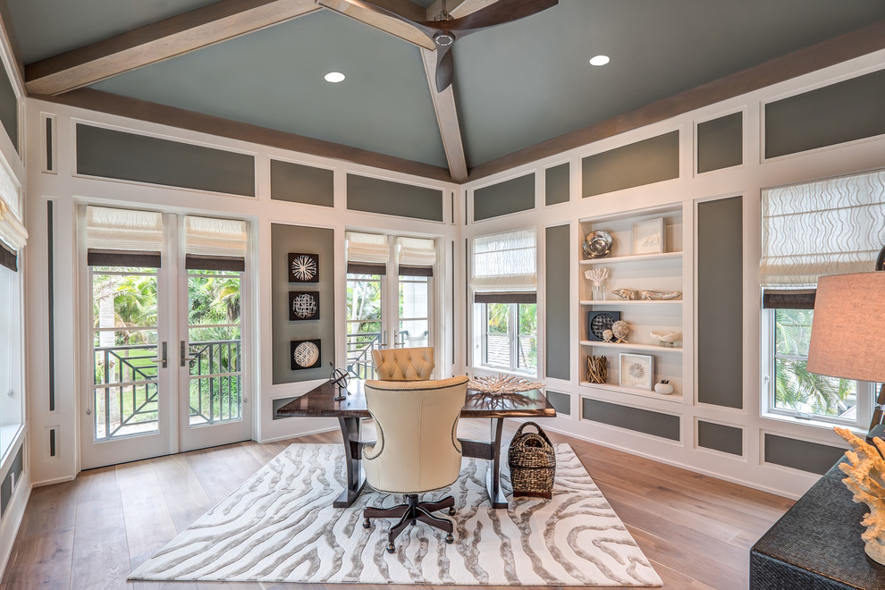 home office with surround windows and wood floors