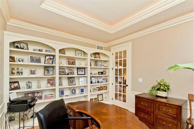 Large elegant freestanding desk light wood floor study room photo in Columbus with beige walls and no fireplace