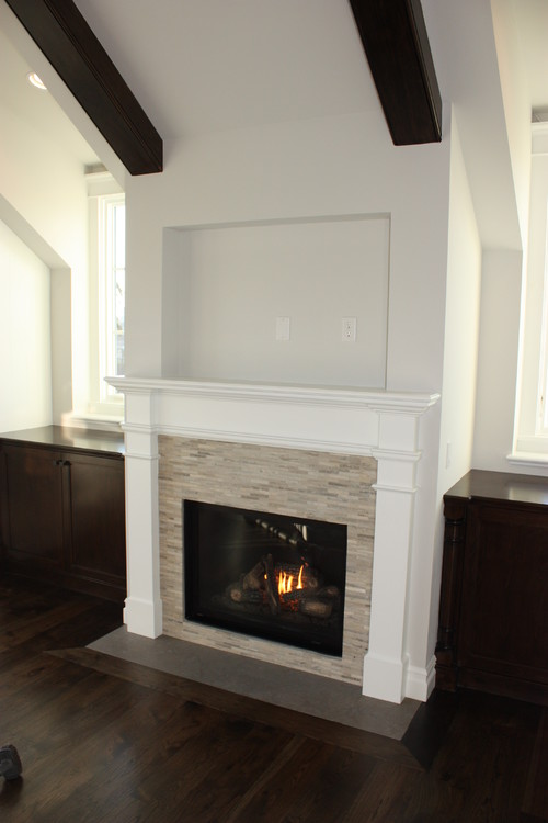 What is the stacking stone used on this fireplace surround? Also, do you know who the ...
