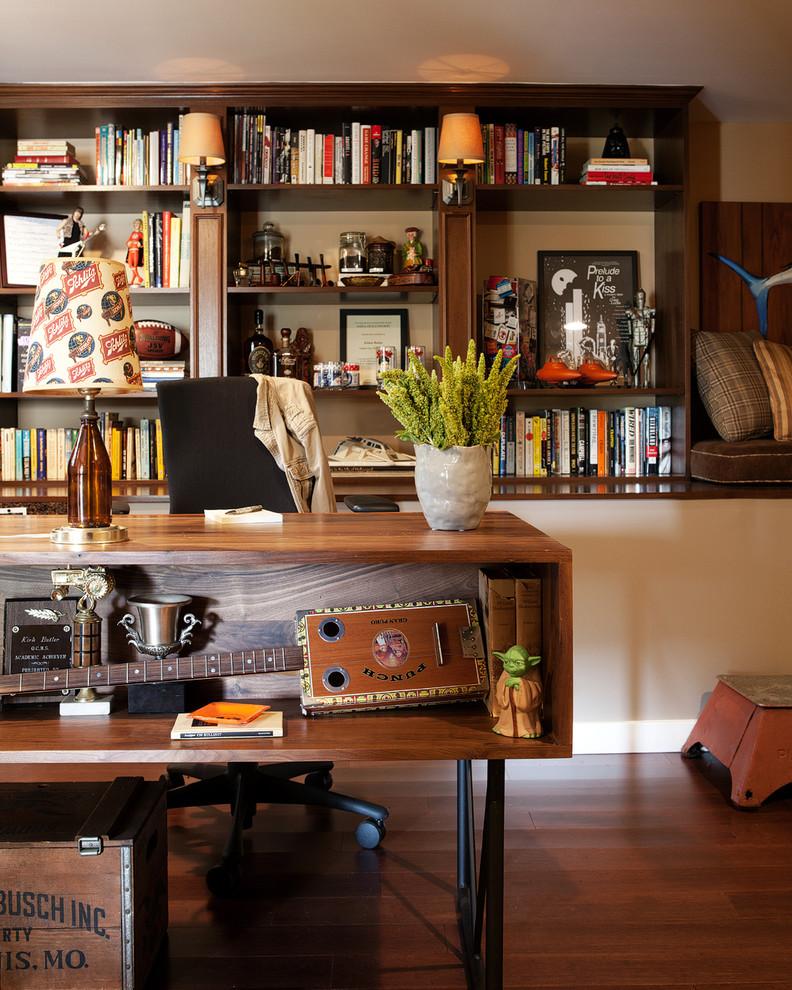 Home office - eclectic freestanding desk dark wood floor home office idea in Los Angeles with beige walls