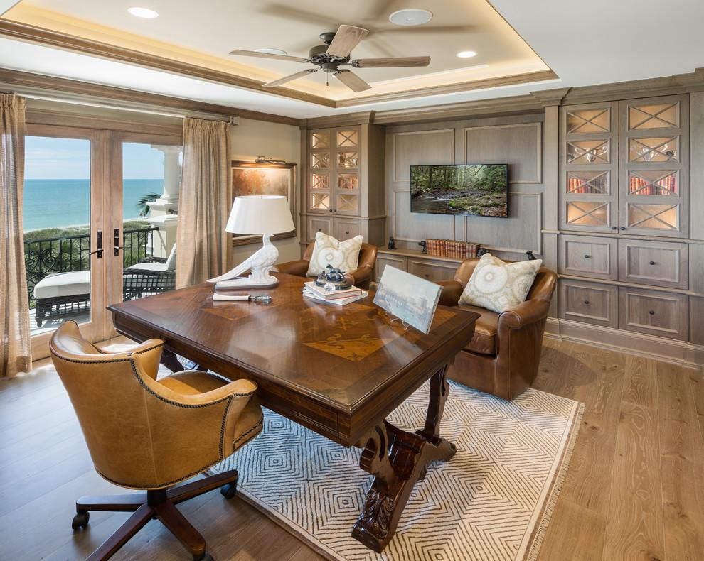 Study room - huge traditional freestanding desk medium tone wood floor study room idea in Tampa with gray walls