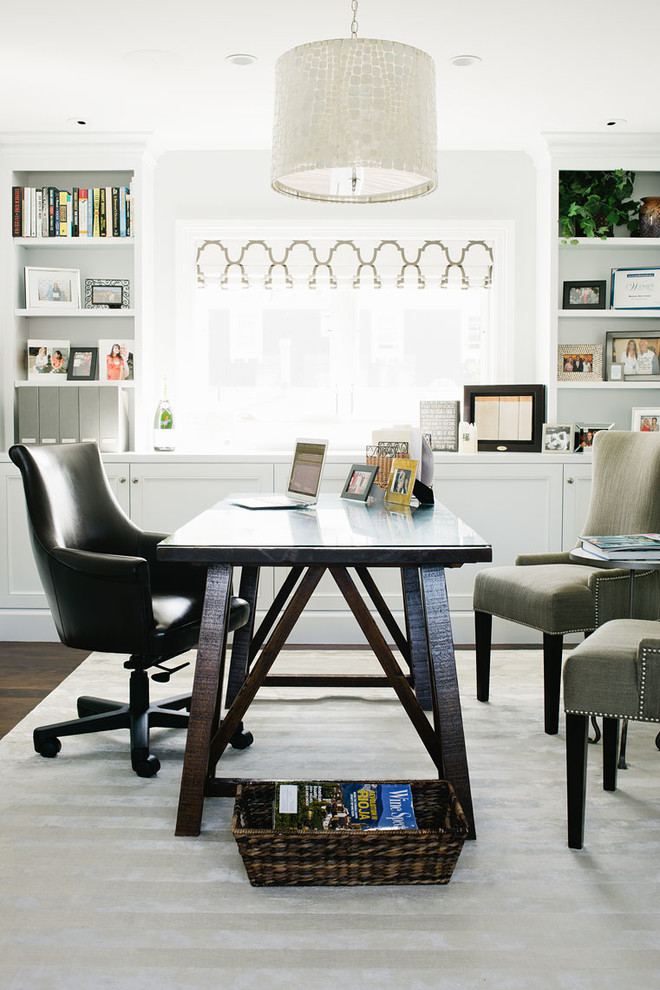 Inspiration for a coastal freestanding desk study room remodel in Los Angeles with white walls