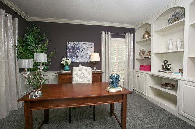 transitional home office idea with purple walls carpet and a freestanding desk