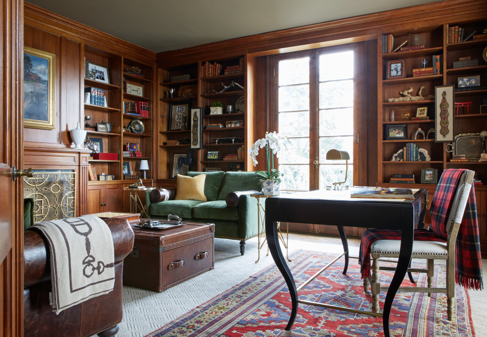 Elegant freestanding desk home office library photo in Nashville with a standard fireplace, a stone fireplace and brown walls