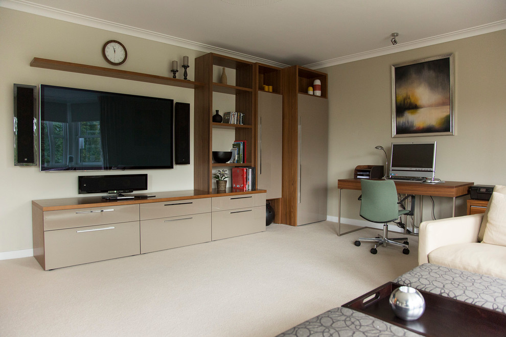 Home office - mid-sized contemporary carpeted home office idea in London with gray walls and no fireplace