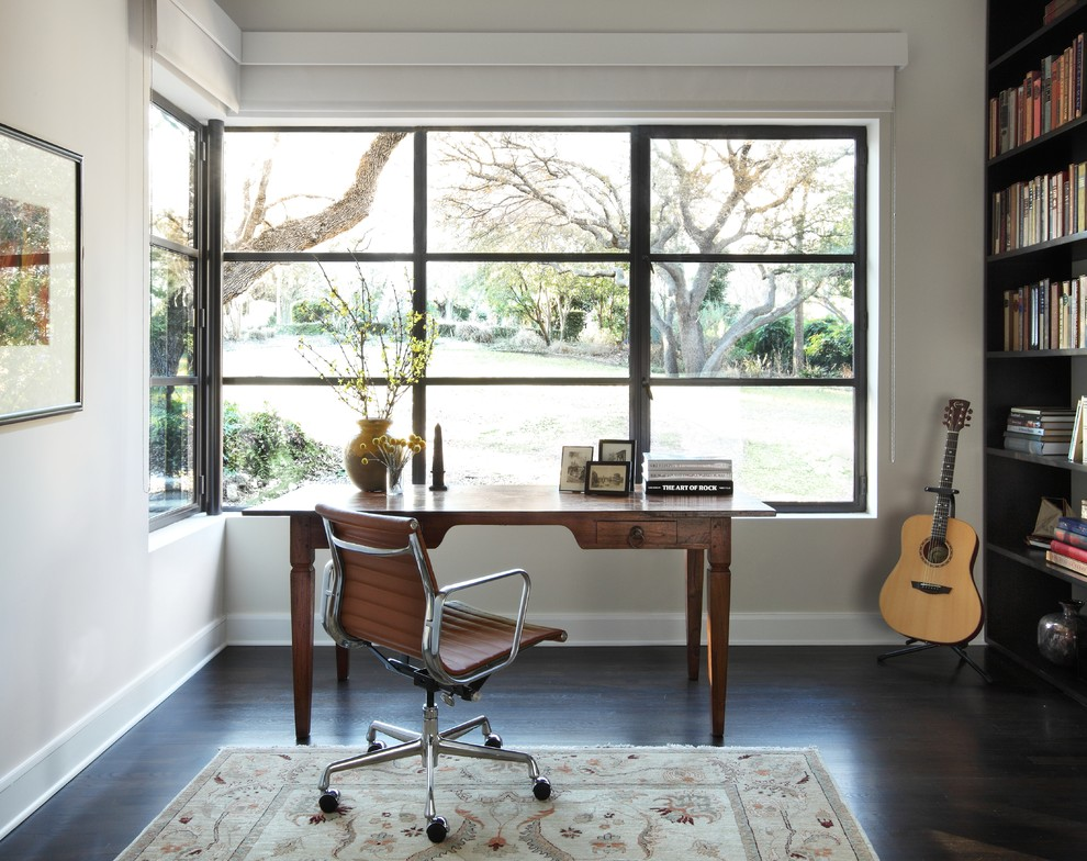 Home office - contemporary freestanding desk dark wood floor and brown floor home office idea in Austin with white walls