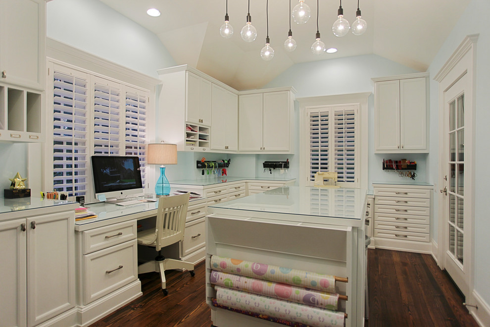 Craft room - traditional craft room idea in Houston with blue walls
