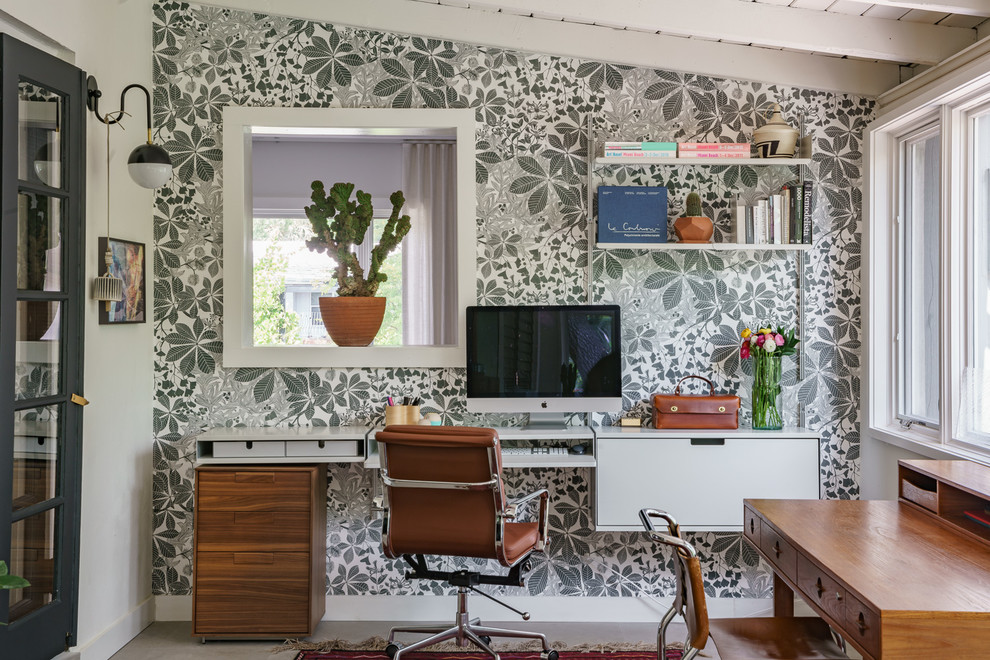 Example of a 1960s built-in desk gray floor home office design in Miami with gray walls