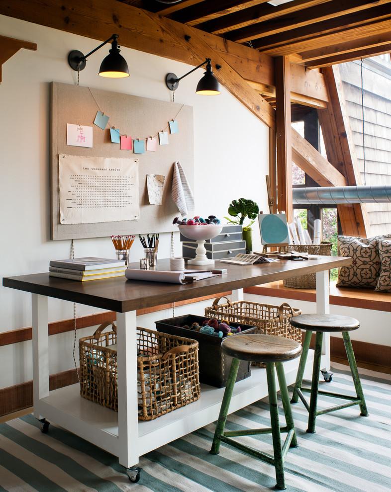 Home studio - contemporary freestanding desk home studio idea in San Francisco with white walls