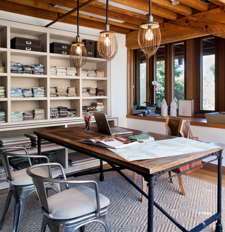 Trendy freestanding desk medium tone wood floor home studio photo in San Francisco with white walls