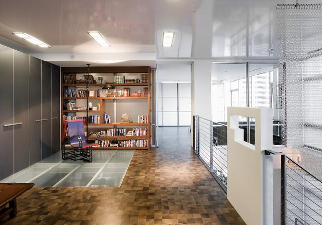 Example of a trendy dark wood floor home office design in Seattle