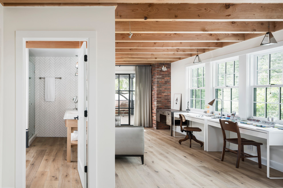 Inspiration for a cottage freestanding desk light wood floor and beige floor study room remodel in Austin with white walls