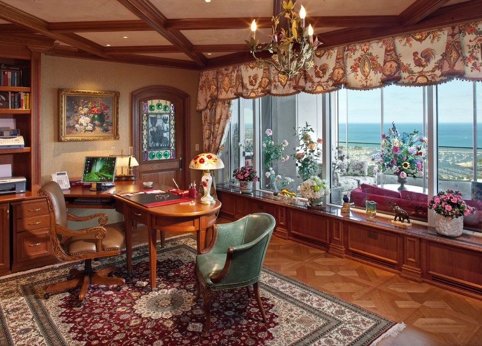 Tuscan freestanding desk medium tone wood floor home office photo in Milwaukee