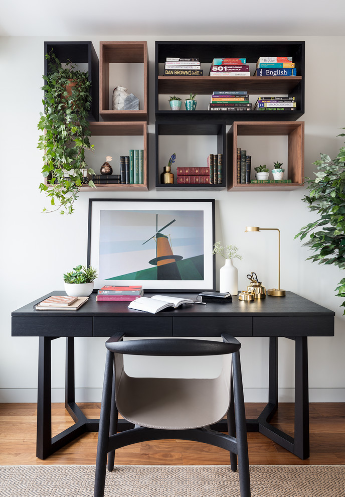 Example of a small minimalist freestanding desk study room design in London