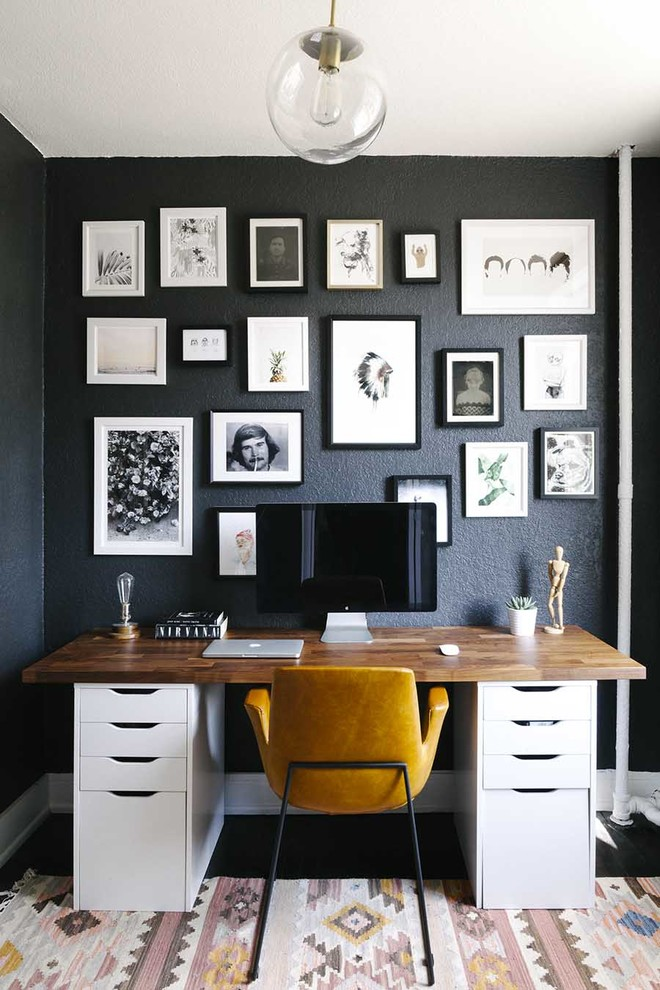 Inspiration for a mid-sized scandinavian freestanding desk study room remodel in Boston with black walls