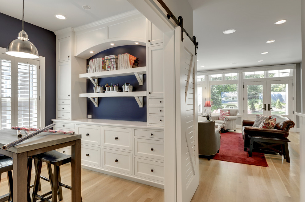 Craft room - traditional craft room idea in Minneapolis with blue walls