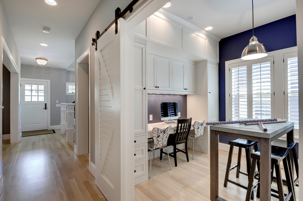 Home office - traditional built-in desk home office idea in Minneapolis with blue walls