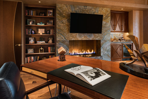 Picasso quartzite fireplace in an office