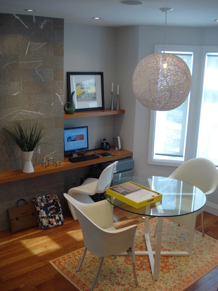 Home office - modern medium tone wood floor home office idea in Toronto with gray walls