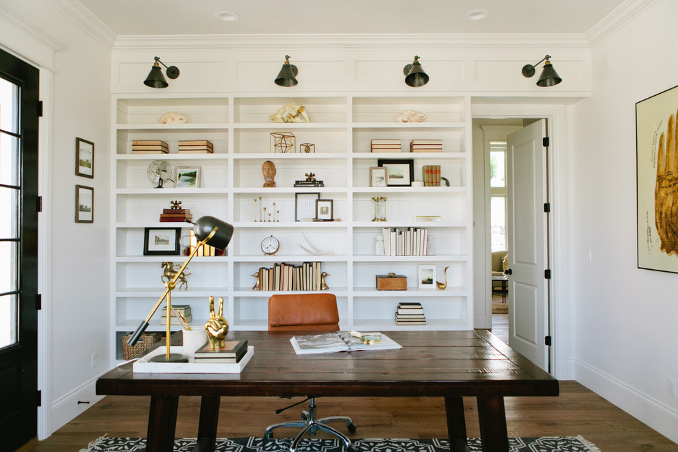 Inspiration for a farmhouse freestanding desk dark wood floor study room remodel in Salt Lake City with white walls