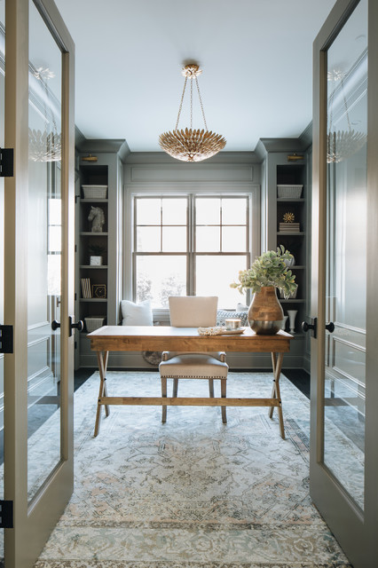 Home office - cottage freestanding desk dark wood floor and brown floor home office idea in Chicago with gray walls