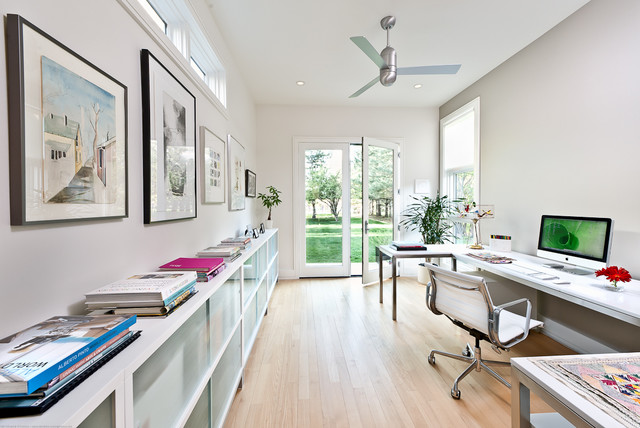 Example Of A Large Trendy Freestanding Desk Light Wood Floor And Beige  Floor Home Office Design