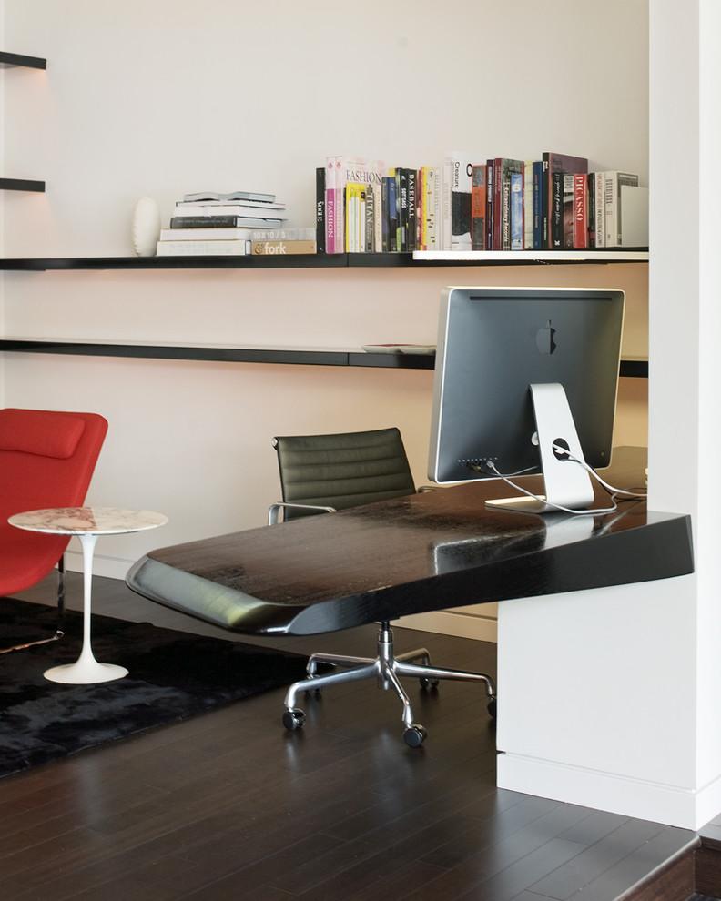 Minimalist built-in desk dark wood floor home office photo in Kansas City with white walls