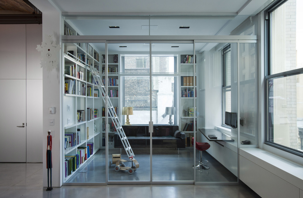 Example of an urban concrete floor home office design in New York