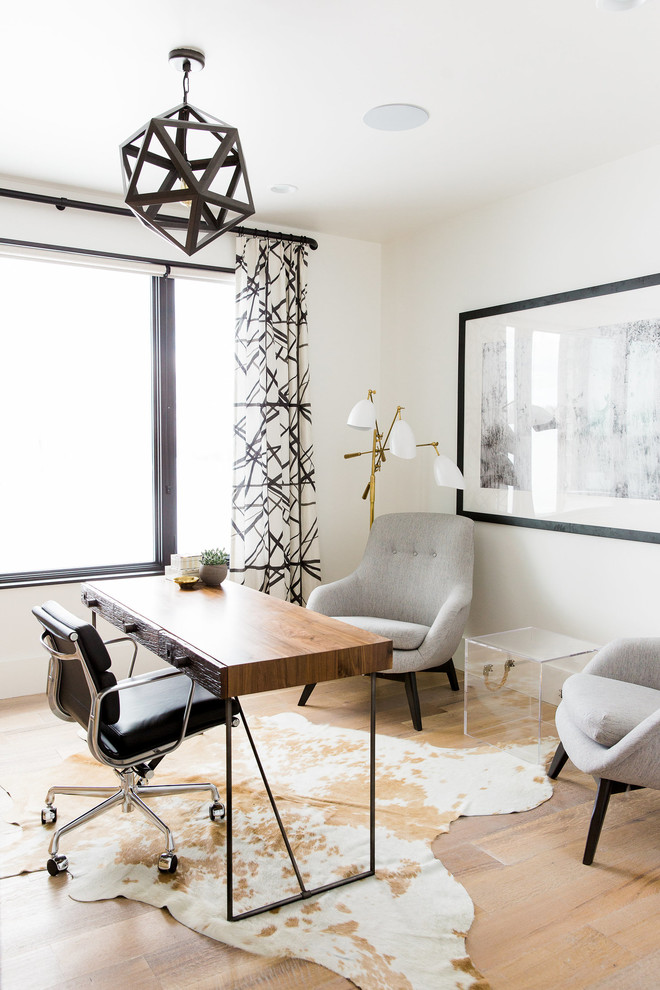 Transitional freestanding desk light wood floor study room photo in Salt Lake City with white walls and no fireplace