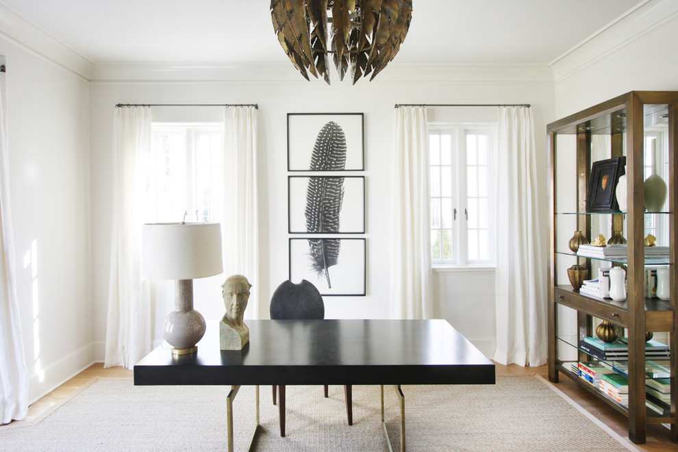 Inspiration for a transitional freestanding desk home office remodel in Charlotte with white walls