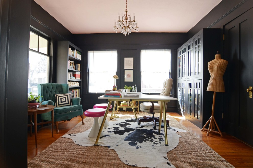 Example of an eclectic freestanding desk home office design in Dallas with black walls