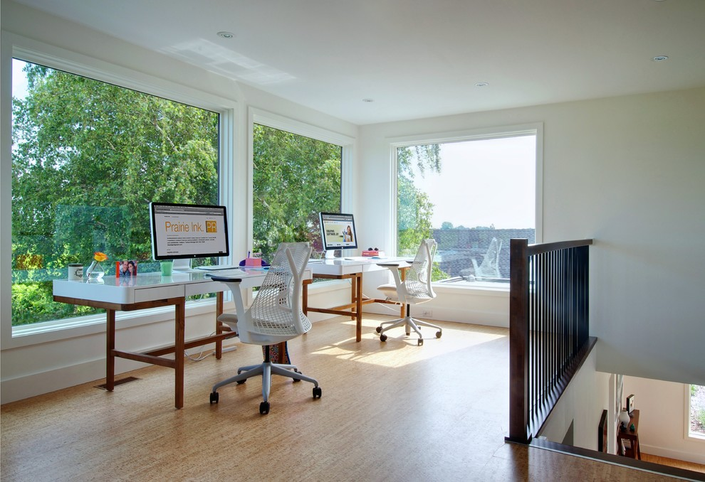 Trendy freestanding desk home office photo in Toronto with white walls