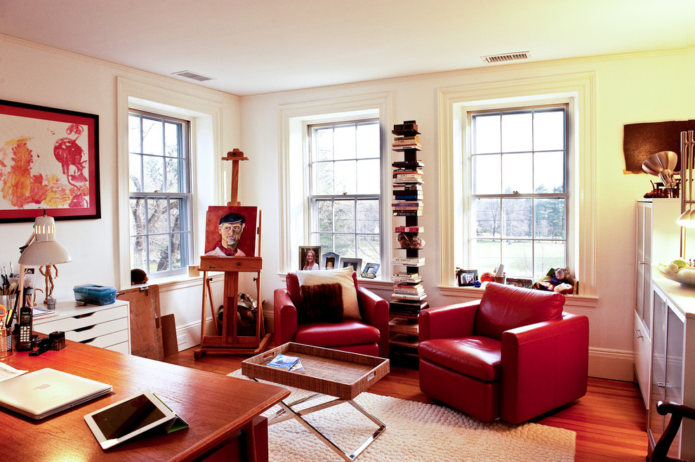 Eclectic medium tone wood floor home office photo in Boston with white walls