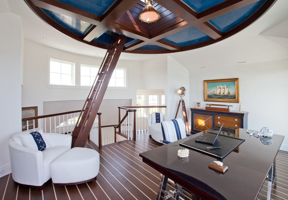 Mid-sized beach style freestanding desk dark wood floor study room photo in Boston with white walls