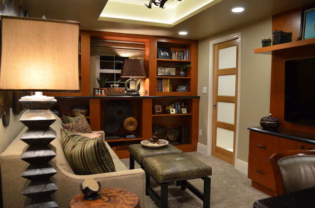 Example of a transitional home office design in Miami