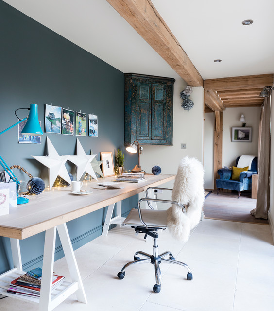 Inspiration for a rustic freestanding desk study room remodel in West Midlands with blue walls