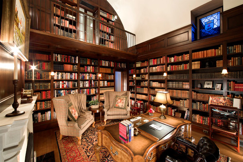 Massive library office with cozy armchairs.