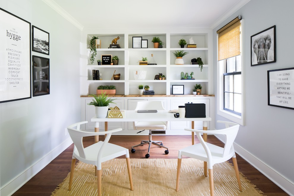 Inspiration for a transitional freestanding desk medium tone wood floor and brown floor home office remodel in Bridgeport with gray walls