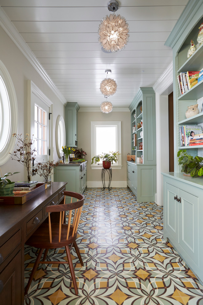 Study room - large farmhouse freestanding desk multicolored floor and concrete floor study room idea in New York with beige walls and no fireplace
