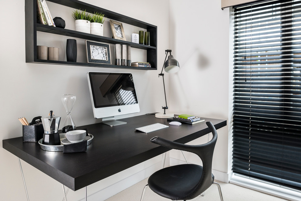 Small trendy freestanding desk beige floor study room photo in Hampshire with white walls