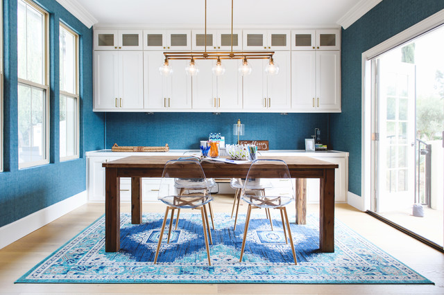 Example of a coastal freestanding desk light wood floor home office design in San Diego with blue walls and no fireplace