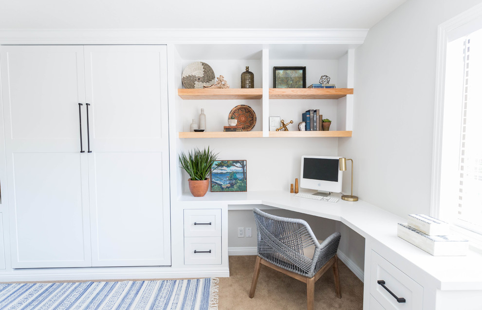 Mid-sized 1960s built-in desk carpeted and beige floor study room photo in San Diego with white walls