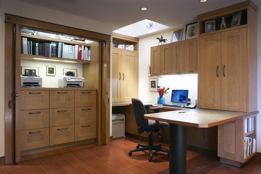 Inspiration for a contemporary built-in desk medium tone wood floor home office remodel in San Francisco with white walls