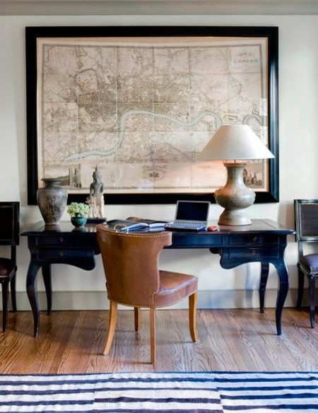 Home office with large framed map