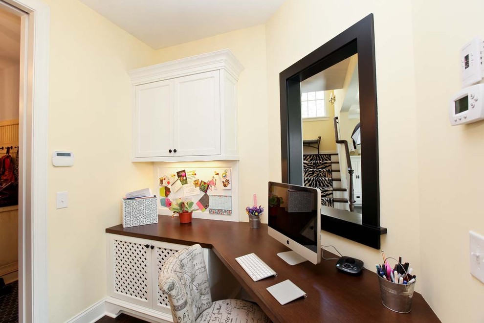 Home office - traditional built-in desk home office idea in Minneapolis